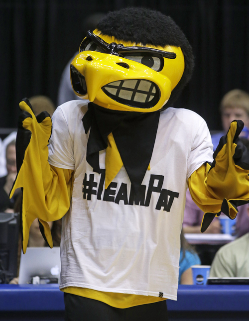 """""""Herky,"""" the Iowa mascot, wears a T-shirt supporting Pat McCaffery, son of Iowa head coach Fran McCaffery, at halftime of a first-round game against Tennessee in the NCAA college basketball tournament on Wednesday, March 19, 2014, in Dayton, Ohio. Coach McCaffery flew home to be with his 13-year-old son who had a tumor removed Wednesday morning and then flew back to Dayton for their game against Tennessee. (AP Photo/Al Behrman)"""