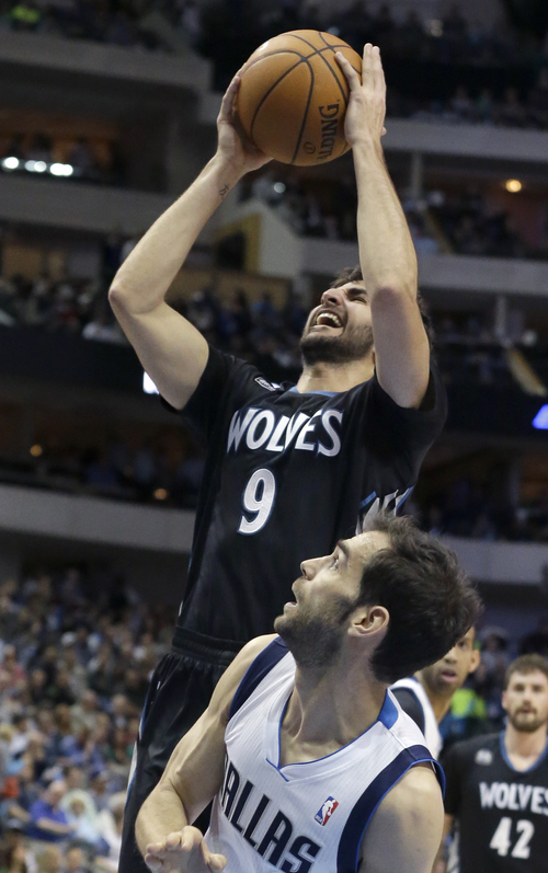 Minnesota Timberwolves guard Ricky Rubio (9) of Spain shoot over Dallas Mavericks guard Jose Calderon (8) of Spain during the first half an NBA basketball game Wednesday, March 19, 2014, in Dallas. The Timberwolves won in overtime 123-122. (AP Photo/LM Otero)