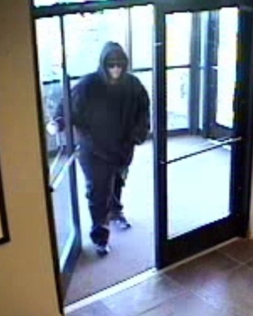   Courtesy The West Jordan Police Department is requesting help in identifying the suspect who robbed a Mountain America Credit Union on March 21, 2014. The branch located at 6761 S. Redwood Road was robbed just after 9 a.m. by a man dressed in black: black hooded sweat-shirt, black pants and dark sunglasses. The suspect is believed to be 5 foot 6 to 5-10, with a clean shaven face and weighed between 250 to 300 pounds. He left the scene on foot.