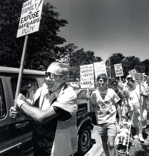 This July 1, 1991 file photo, Fred Phelps Sr., demonstrates  in Topeka's Gage Park in Topeka, Kan.  Phelps, the fiery founder of the Westboro Baptist Church, a small Kansas church,  who drew international condemnation for outrageous and hate-filled protests that blamed almost everything, including the deaths of AIDS victims and U.S. soldiers, on America's tolerance for gay people, has died the family said Thursday, March 20, 2014. He was 84.  (AP Photo/The Topeka Capital Journal)
