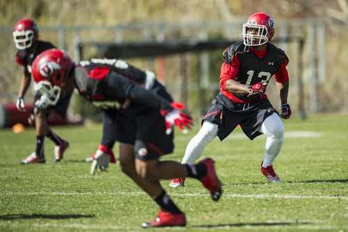 Chris Detrick  |  The Salt Lake Tribune Utah linebacker Gionni Paul runs drills during a practice at Spence and Cleone Eccles Football Center Thursday March 20, 2014.