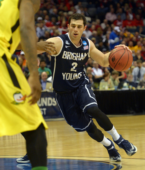 Rick Egan  | The Salt Lake Tribune   Brigham Young Cougars guard Matt Carlino (2) takes the ball around the key, in second round NCAA Championship action, BYU vs. Oregon, in Milwaukee, Thursday, March 20, 2014.