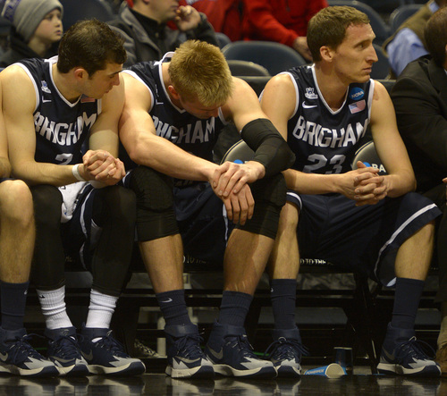 Rick Egan  | The Salt Lake Tribune    Brigham Young Cougars, Matt Carlino (2),Eric Mika (00) and Skyler Halford (23) watch as the Ducks extend their lead to more than 30 points in the final minutes of the game, in second round NCAA Championship action, BYU vs. Oregon, in Milwaukee, Thursday, March 20, 2014.  Oregon won the game 87-68.