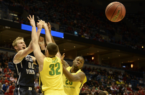 Rick Egan  | The Salt Lake Tribune    Brigham Young Cougars forward Eric Mika gets a pass off, as he is double-teamed by Oregon Ducks forward Ben Carter (32) and Oregon Ducks forward Elgin Cook (23), in second round NCAA Championship action, BYU vs. Oregon, in Milwaukee, Thursday, March 20, 2014.