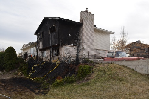 Courtesy of Provo Fire Department Children playing with matches are believed to have started this house fire, which began in some bushes.