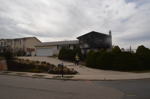 Courtesy photo | Provo Fire Department  Children playing with matches are believed to have started this house fire, which began in some bushes.