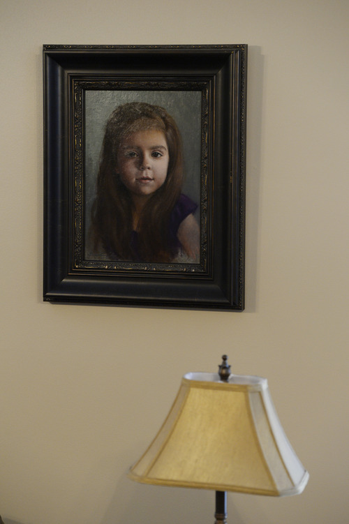"""Francisco Kjolseth     The Salt Lake Tribune A donated portrait hangs on the wall of Charlee Nelson, 6, who suffered from Late Infant Batten Disease, a terminal inherited disorder of the nervous system that leads to seizures, loss of vision and motor skills. Gov. Gary Herbert signed """"Charlee's Law"""" after Charlee died last weekend. The law will make cannabis oil available on a trial basis."""