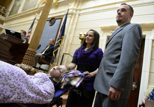 Francisco Kjolseth  |  The Salt Lake Tribune Catrina and Jeff Nelson alongside their daughter, Charlee, 6, who suffered from Late Infant Batten Disease, a terminal inherited disorder of the nervous system. The family was acknowledged on the Senate floor at the Utah Capitol after senators unanimously passed HB105,which would provide access to cannabis oil for epileptic kids, on Tuesday, March 11, 2014.