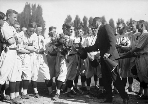 "Claud ""Lefty"" Williams , who spent two years developing as a pitcher in the Pacific Coast League for Salt Lake City as well as Sacramento, presents a member of the Salt Lake Red Sox with an award in 1915. Following 1915, the Chicago White Sox purchased Williams' contract. He is best known for his involvement in the ""Black"" Sox scandal where he and other players attempted to fix the world series for money. He was consequently banned from baseball for life."