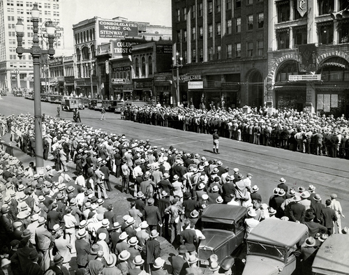 "Tribune file photo  Baseball fans gather to keep track of a game on ""Old Ironsides"" outside the Tribune's building."