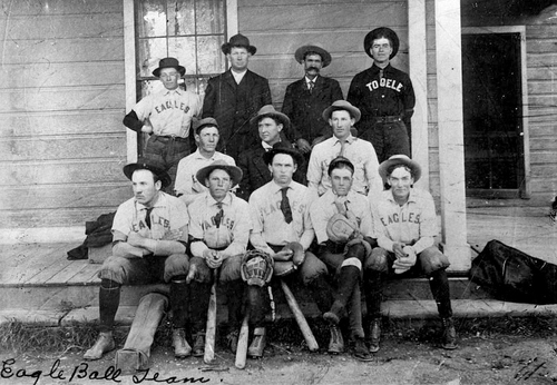The Eagle baseball team photographed in 1908 in Grantsville, Utah. Front row, left to right: Fred England, Oliver DeLaMare, Hugh Gowans, Rom DeLaMare, Leslie Warburton. Middle row: Ray Lee, Tom Coleman, manager, Azile England. Back row: Rollo Nelson, David Heggie, teamster, Alex McLaws, Willard McLaws.