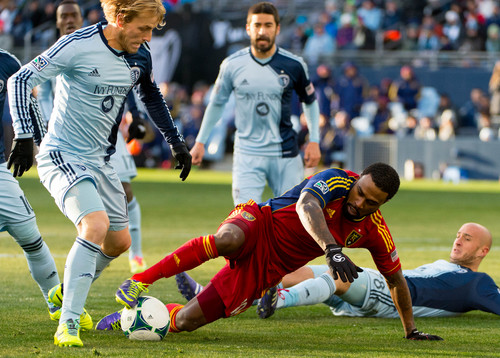 Trent Nelson  |  The Salt Lake Tribune Real Salt Lake's Robbie Findley (10) tries to control the ball as Sporting KC's Chance Myers (7) moves in as Real Salt Lake faces Sporting KC in the MLS Cup Final at Sporting Park in Kansas City, Saturday December 7, 2013.