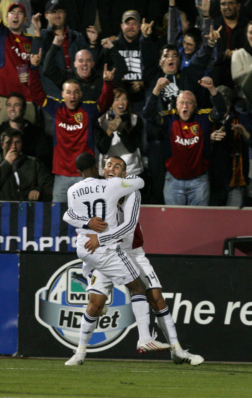 RSL vs COLORADO Yura Movsisyan and Robbie Findley celebrate Movsisyan's game-tying goal that sends RSL to the MSL playoffs. Real Salt Lake scores a very late goal to tie and advance to the MSL playoffs. Scott Sommerdorf / The Salt Lake Tribune