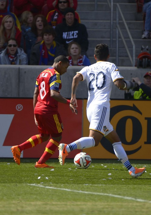 Leah Hogsten  |  The Salt Lake Tribune Real Salt Lake forward Joao Plata (8) grabs his left hamstring during a fierce dribble with Los Angeles Galaxy defender A.J. DeLaGarza (20) by his side. Plata's injury forced him off in the 34th minute with a left hamstring strain, described as moderate.