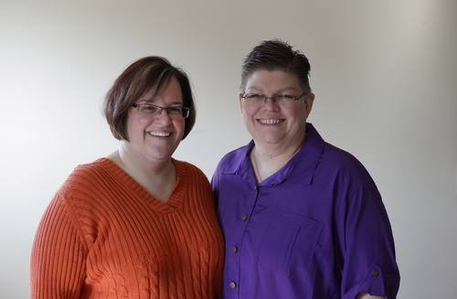 FILE - In this March 5, 2013, file photo, April DeBoer, left, and Jayne Rowse pose at their home in Hazel Park, Mich. A federal judge has struck down Michigan's ban on gay marriage Friday, March 21, 2014, the latest in a series of decisions overturning similar laws across the U.S. The two nurses who've been partners for eight years claimed the ban violated their rights under the U.S. Constitution. (AP Photo/Paul Sancya, File)