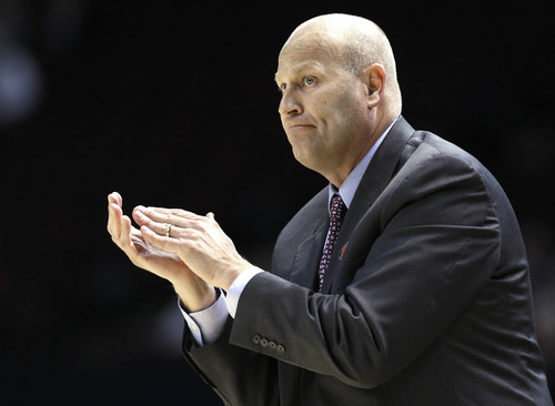Gonzaga coach Kelly Graves cheers on his team in the first half Sunday, March 23, 2014, of their first-round NCAA women's basketball game against the James Madison in College Station, Texas.  (AP Photo/Pat Sullivan)