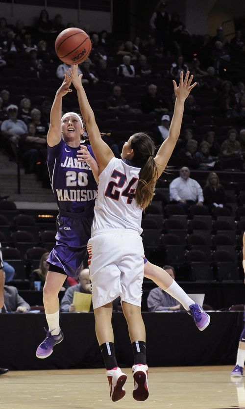 James Madison 's Kirby Burkholder (20) shoots over Gonzaga 's Keani Albanez (24) in the first half  Sunday, March 23, 2014, in a first-round NCAA women's basketball game in College Station, Texas.  (AP Photo/Pat Sullivan)