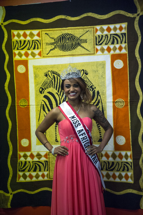 "Chris Detrick  |  The Salt Lake Tribune The newly crowned Miss Africa Utah Muluwerk Hale poses for pictures during a crowing ceremony at One World Gifts in Sugar House Saturday March 22, 2014. Miss Ethiopia, Muluwerk Hale, became Miss Africa Utah after Winnet Murahwa, Miss Zimbabwe, stepped down. ""After carefully contemplating on my responsibilities as the queen, I realized that I cannot fulfill all the responsibilities expected of me due to personal reasons,"" Murahwa said in a statement."