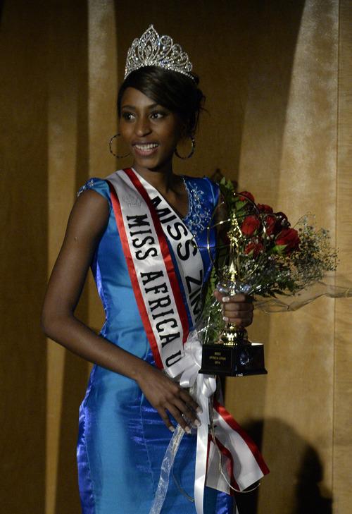 Rick Egan  | The Salt Lake Tribune   Winnet Murahwa, Miss Zimbabwe, takes her victory walk after being crowned Miss Africa Utah, Saturday, March 8, 2014.