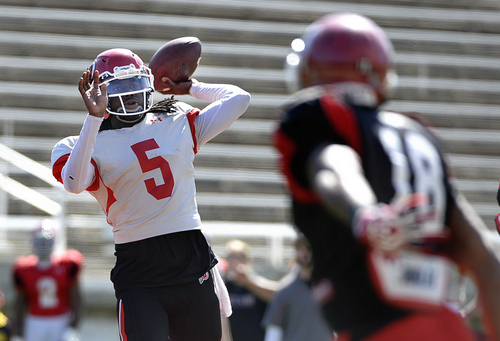 Scott Sommerdorf   |  The Salt Lake Tribune Utah QB Brandon Cox looks to throw as Utah CB Eric Rowe rushes him on a CB blitz during Utah football practice at Rice Eccles Stadium, Saturday, March 22, 2014.