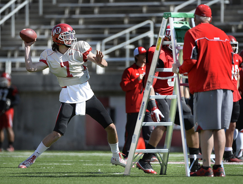 Scott Sommerdorf   |  The Salt Lake Tribune Utah QB Travis Wilson throws as aluminum ladders represent the pass rush during Utah football practice at Rice Eccles Stadium, Saturday, March 22, 2014.