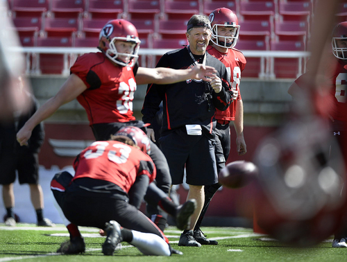 Scott Sommerdorf   |  The Salt Lake Tribune Utah head coach Kyle Whittingham watches as K Andy Phillips practices field goal kicking during Utah football practice at Rice Eccles Stadium, Saturday, March 22, 2014.