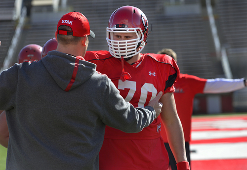 Scott Sommerdorf   |  The Salt Lake Tribune Former Brighton OL Jackson Barton is coached by new Utah offensive line coach Jim Harding during Utah football practice at Rice Eccles Stadium, Saturday, March 22, 2014.