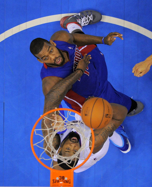Detroit Pistons forward Greg Monroe, top, puts up a shot as Los Angeles Clippers center DeAndre Jordan defends during the second half of an NBA basketball game, Saturday, March 22, 2014, in Los Angeles. The Clippers won 112-103. (AP Photo/Mark J. Terrill)