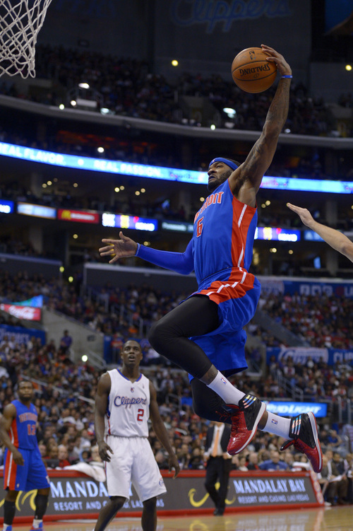 Detroit Pistons forward Josh Smith, right, goes up for a shot as Los Angeles Clippers guard Darren Collison looks on during the second half of an NBA basketball game, Saturday, March 22, 2014, in Los Angeles. The Clippers won 112-103. (AP Photo/Mark J. Terrill)