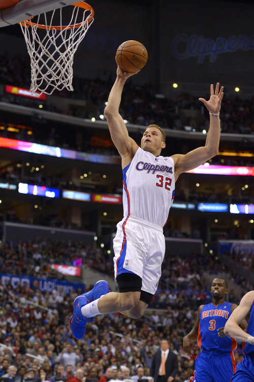 Los Angeles Clippers forward Blake Griffin, left, goes up for a dunk as Detroit Pistons guard Rodney Stuckey watches during the first half of an NBA basketball game, Saturday, March 22, 2014, in Los Angeles. (AP Photo/Mark J. Terrill)