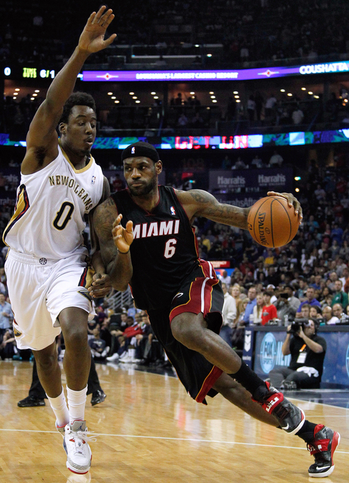 Miami Heat forward LeBron James (6) drives against New Orleans Pelicans forward Al-Farouq Aminu (0) during the first half of an NBA basketball game in New Orleans, Saturday, March 22, 2014. (AP Photo/Jonathan Bachman)