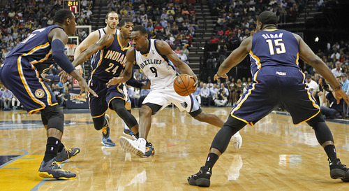 Memphis Grizzlies guard Tony Allen (9) drives to the basket against Indiana Pacers center Ian Mahinmi, left, of France, forward Paul George (24) and guard Donald Sloan (15) in the first half of an NBA basketball game on Saturday, March 22, 2014, in Memphis, Tenn. (AP Photo/Lance Murphey)