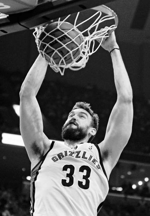 Memphis Grizzlies center Marc Gasol (33), of Spain, dunks the ball against the Indiana Pacers in the first half of an NBA basketball game on Saturday, March 22, 2014, in Memphis, Tenn. (AP Photo/Lance Murphey)