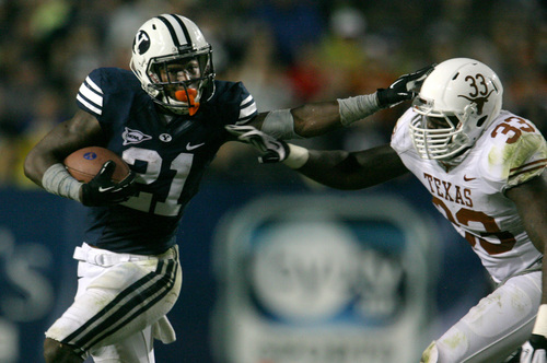 Rick Egan  | The Salt Lake Tribune   Brigham Young Cougars running back Jamaal Williams (21) gets past Texas Longhorns linebacker Steve Edmond (33) in the Cougars 40-21 win over the University of Texas at Lavell Edwards stadium, Saturday, September 7, 2013.