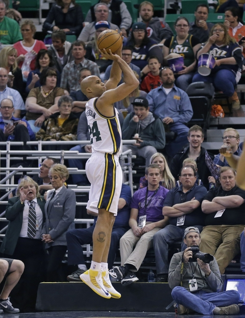 Utah Jazz's Richard Jefferson (24) shoots against the Orlando Magic in the first quarter during an NBA basketball game on Saturday, March 22, 2014, in Salt Lake City. (AP Photo/Rick Bowmer)