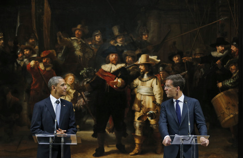 U.S. President Barack Obama, left, looks at Dutch Prime Minister Mark Rutte, right, in front of  Dutch master Rembrandt's The Night Watch painting during a visit to the Rijksmuseum in Amsterdam, Netherlands, Monday, March 24, 2014. Obama will attend the two-day Nuclear Security Summit in The Hague. (AP Photo/Jerry Lampen, POOL)