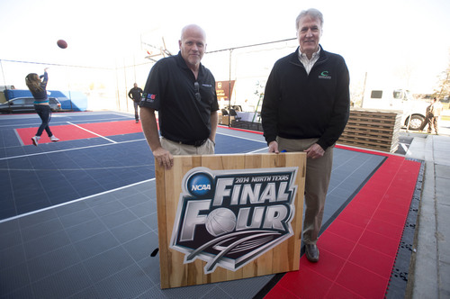 Steve Griffin  |  The Salt Lake Tribune   Joel McCausland, director of Sport Court Products, and Ron Cerny, President and CEO of Connor Sport Court International, with a piece of this year's Final Four court that will be installed in AT&T Stadium in Dallas. The floor was loaded into trucks at the company's offices in Salt Lake City Monday, March 24, 2014 and will be installed for the April 5th start of the Final Four.
