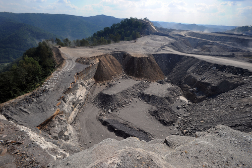 """FILE - This Sept. 18, 2008 file photo shows a mountaintop removal mining site at Kayford Mountain, W.Va. The House is taking up a bill to prevent the Obama administration from imposing a stream-protection rule for coal mining that government experts say would  eliminate thousands of jobs. The rules are supposed to replace Bush-era regulations that set up buffer zones around streams and were aimed chiefly at mountaintop removal mining in Appalachia. Republicans say they are part of Obama's """"war on coal.'' (AP Photo/Jeff Gentner, File)"""