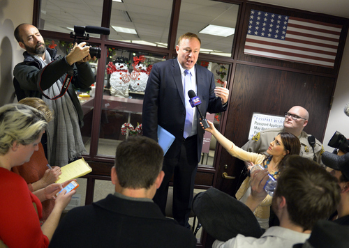 Keith Johnson | The Salt Lake Tribune  Utah Sen. Jim Dabakis stands on a chair outside the Salt Lake County clerks office, Friday, December 20, 2013, to explain to the crowd gathered outside that the office will close until Monday. Hundreds flocked to the office seeking marriage licenses after a federal judge in Utah Friday struck down the state's ban on same-sex marriage, saying the law violates the U.S. Constitution's guarantees of equal protection and due process.
