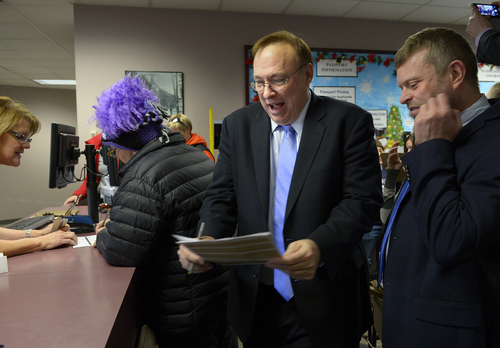 Scott Sommerdorf   |  The Salt Lake Tribune Utah State Senator Jim Dabakis, center deals with the paperwork of a marriage license as his partner Stephen Justesen waits at right as others also see the clerks at the marriage license division offices at the Salt Lake County offices, Friday December 20, 2013.