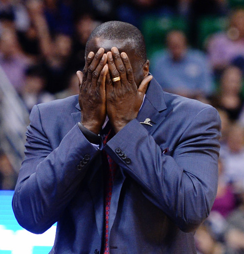 Steve Griffin  |  The Salt Lake Tribune   Utah Jazz head coach Tyrone Corbin holds his face in his hands after a call was called during first half action in the Jazz versus Mavericks game at EnergySolutions Arena in Salt Lake City, Utah Wednesday, March 12, 2014.