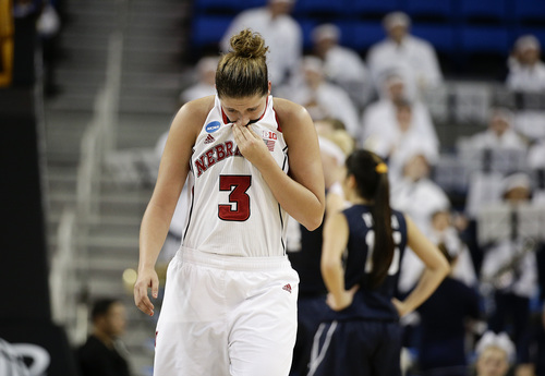 Nebraska's Hailie Sample wipes her face as she walks on the court during the first half of a second-round NCAA women's college basketball game against BYU on Monday, March 24, 2014, in Los Angeles. (AP Photo/Jae C. Hong)