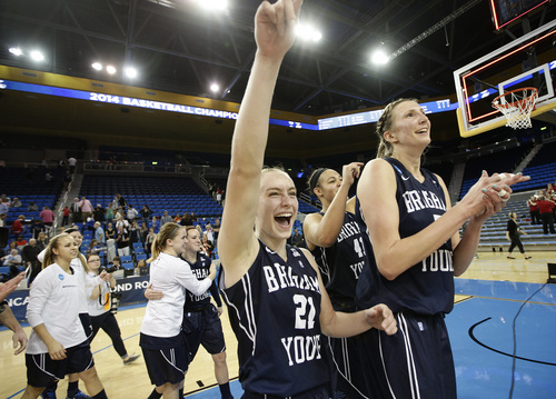 BYU's Lexi Eaton, center, and Jennifer Hamson celebrate their team's 80-76 win against Nebraska in a second-round game of the NCAA women's college basketball tournament on Monday, March 24, 2014, in Los Angeles.  (AP Photo/Jae C. Hong)