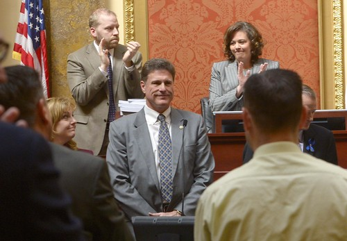 Leah Hogsten  |  The Salt Lake Tribune Rep. Jim Dunnigan, R-Taylorsville, chairman of the investigative committee, and fellow legislators on the committee are applauded for their efforts after presenting their final report, Wednesday, March, 12, 2014, to the Utah House, into former Attorney General John Swallow.  A stack of more than 200 pages with 3,700 exhibits was submitted as the result of a four-month, $4 million investigation, which contributed to Swallow's resignation.