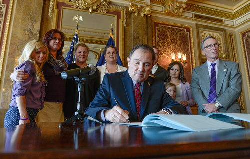 "Franciso Kjolseth  |  The Salt Lake Tribune Gov.Gary R. Herbert is joined by members Hope 4 Children with Epilepsy as he signs a ceremonial version of HB105  to legalize the use of nonintoxicating cannabis oil by Utahns with untreatable epilepsy. Families gathered in the Gold Room at the Utah Capitol on Tuesday, March 25, 2014, for the signing. HB105, now called ""Charlee's Law,"" will go into effect on July 1."