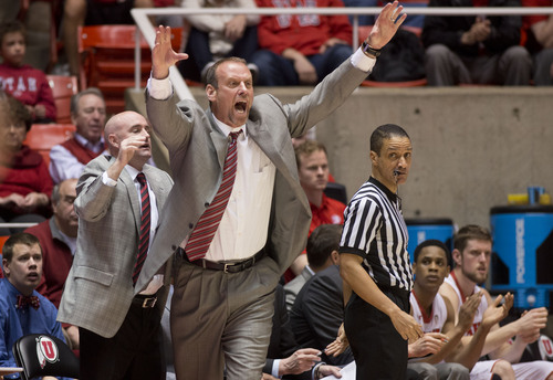 Lennie Mahler  |  The Salt Lake Tribune Utah head coach Larry Krystkowiak motions to players in the first half of a game against Colorado at the Huntsman Center, Saturday, March 1, 2014.