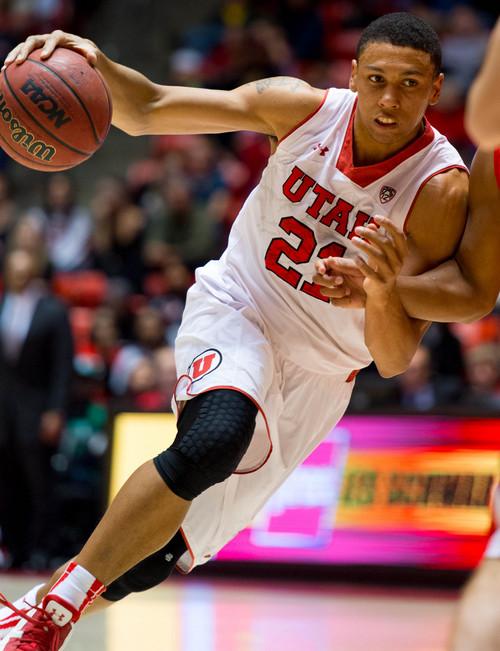 Trent Nelson  |  The Salt Lake Tribune Utah's Jordan Loveridge (21) drives on Ball State's Franko House (15) as the University of Utah hosts Ball State, NCAA basketball Wednesday November 27, 2013 at the Huntsman Center in Salt Lake City.