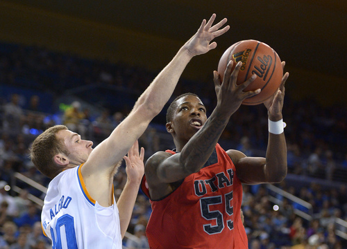 Utah guard Delon Wright, right, puts up a shot as UCLA guard Bryce Alford defends during the first half of an NCAA college basketball game, Saturday, Feb. 15, 2014, in Los Angeles. (AP Photo/Mark J. Terrill)