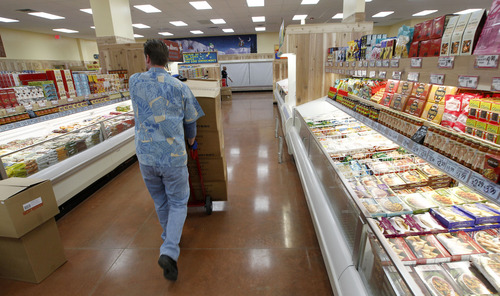 Al Hartmann  |  Tribune file photo Trader Joe's employees stock shelves and organize the 12,700-square-foot store at 634 E. 400 South in Salt Lake City in 2012. The store is opening a second Utah location in Cottonwood Heights in 2015.