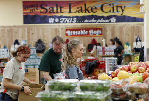 Al Hartmann  |  Tribune fiile photo Trader Joe's employees stock shelves and organize the 12,700-square-foot store at 634 E. 400 South in Salt Lake City in 2012. The chain is opening a second Utah location in Cottonwood Heights in 2015.